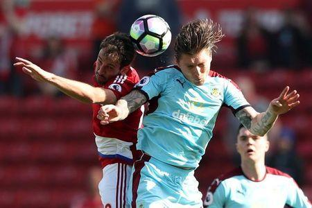 Britain Football Soccer - Middlesbrough v Burnley - Premier League - The Riverside Stadium - 8/4/17 Middlesbrough's Cristhian Stuani in action with Burnley's Jeff Hendrick Reuters / Scott Heppell Livepic