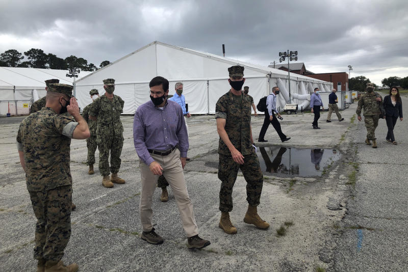 Marine Maj. Gen. James Glynn, on the right, gives Defense Secretary Mark Esper a tour of the temporary tent city that was put up to quarantine new recruits at the Marine Corps' Parris Island Recruit Depot, S.C., May 27, 2020. Recruits are now being housed at the Citadel, the Marine college in Charleston. Glynn is the Parris Island commander.  In ways big and small, the virus is impacting training at the Marine Corps' Parris Island Recruit Depot and across the military. (AP Photo/Lolita Baldor)