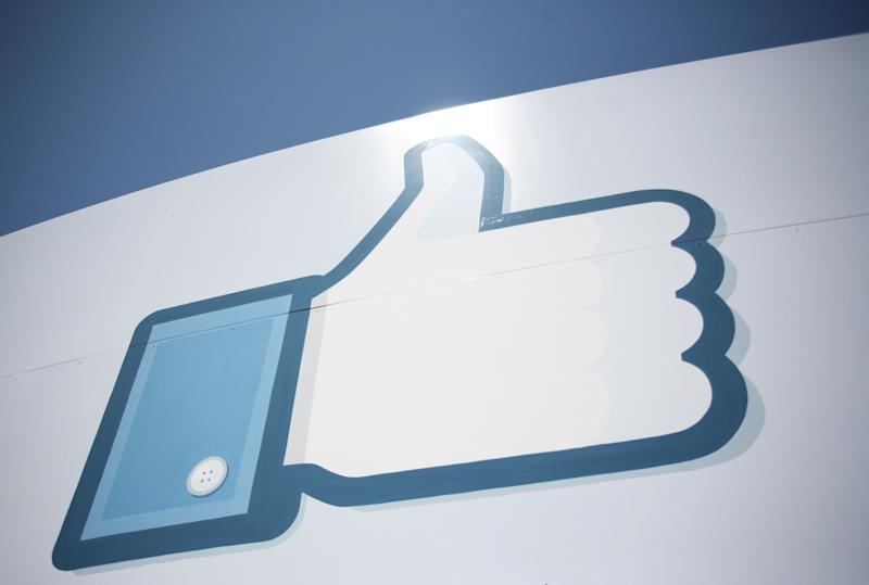 A Facebook Like Button logo is seen at the entrance of the Facebook headquarters in Menlo Park on May 10, 2012 in California. AFP PHOTO / Kimihiro HOSHINO (Photo credit should read KIMIHIRO HOSHINO/AFP/GettyImages)