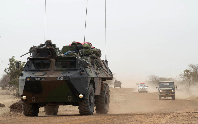In this Monday, Jan. 28, 2013, photo provided by the French Army Communications Audiovisual office (ECPAD) and released Tuesday, Jan. 29, 2013, French forces' armored vehicles head to Timbuktu, in northern Mali. Backed by French helicopters and paratroopers, Malian soldiers entered the fabled city of Timbuktu on Monday after al-Qaida-linked militants who ruled the outpost by fear for nearly 10 months fled into the desert, setting fire to a library that held thousands of manuscripts dating to the Middle Ages. (AP Photo/French Army Communications Audiovisual office (ECPAD), Arnaud Roine)