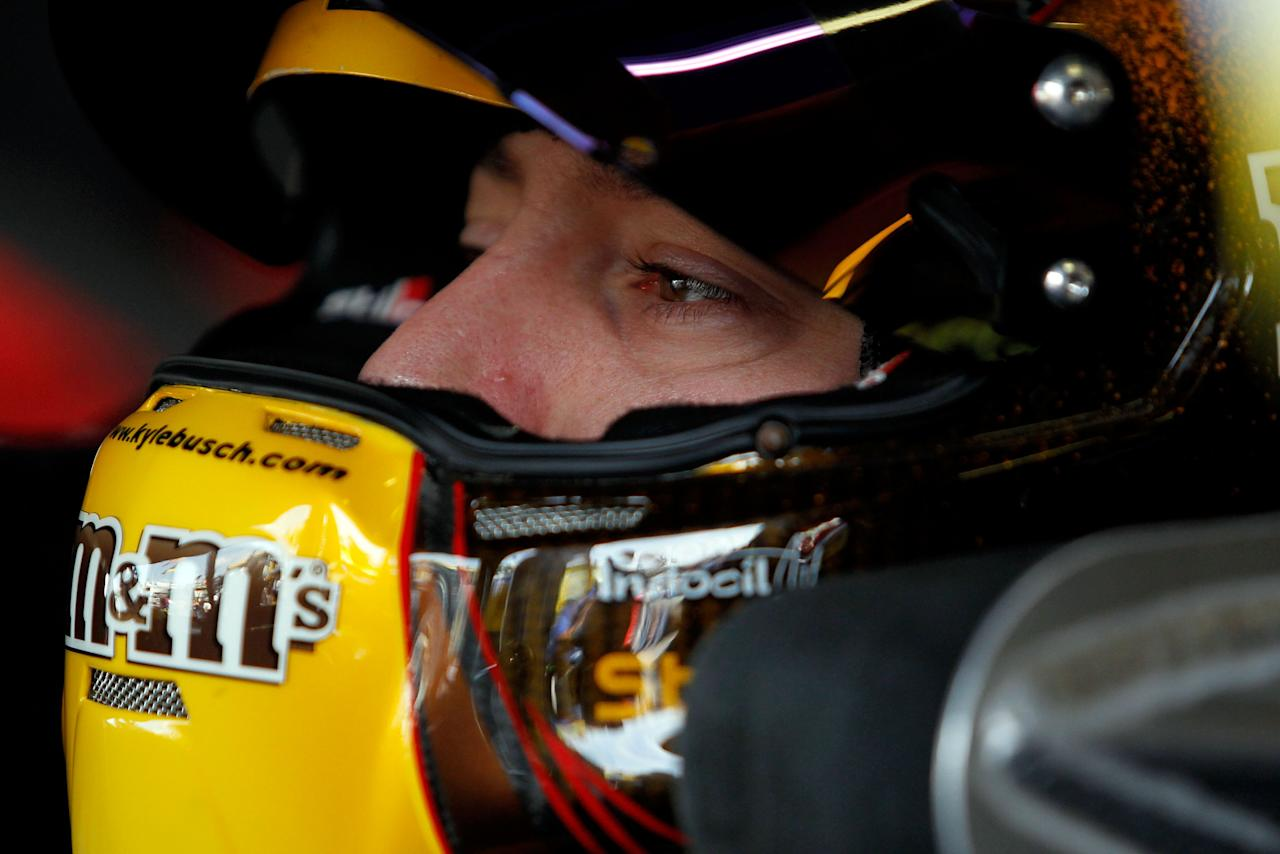 KANSAS CITY, KS - OCTOBER 08:  Kyle Busch, driver of the #18 M&M's Toyota, prepares to drive during practice for the NASCAR Sprint Cup Series Hollywood Casino 400 at Kansas Speedway on October 8, 2011 in Kansas City, Kansas.  (Photo by Tom Pennington/Getty Images)