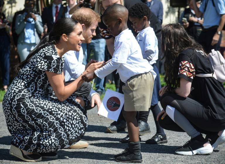 The royal couple attended an education workshop in Nyanga. The township is crippled by violence and crime (AFP Photo/Courtney AFRICA)