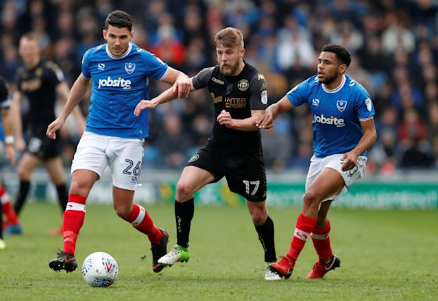 "Soccer Football - League One - Portsmouth vs Wigan Athletic - Fratton Park, Portsmouth, Britain - April 2, 2018 Portsmouth's Gareth Evans (L) and Nathan Thompson (R) in action with Wigan's Michael Jacobs Action Images/Matthew Childs EDITORIAL USE ONLY. No use with unauthorized audio, video, data, fixture lists, club/league logos or ""live"" services. Online in-match use limited to 75 images, no video emulation. No use in betting, games or single club/league/player publications. Please contact your account representative for further details."