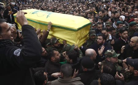 Hezbollah members and supporters carry the coffin of Jihad Moughniyah during his funeral in Beirut's suburbs