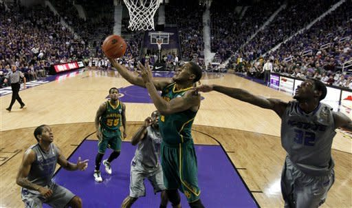 Baylor's Perry Jones III (1) puts up a shot under pressure from Kansas State forward Jamar Samuels (32) during the first half of an NCAA college basketball game, Tuesday, Jan. 10, 2012, in Manhattan, Kan. (AP Photo/Charlie Riedel)