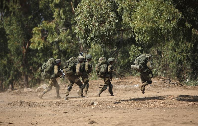 Israeli soldiers take part in a military exercise simulating conflict with Lebanese movement Hezbollah, in the Israeli annexed Golan Heights, near the Syrian border on September 5, 2017