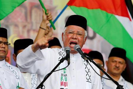 Malaysia's Prime Minister Najib Razak gestures as he speaks during a rally against U.S. President Donald Trump's decision to recognise Jerusalem as the capital of Israel, in Putrajaya