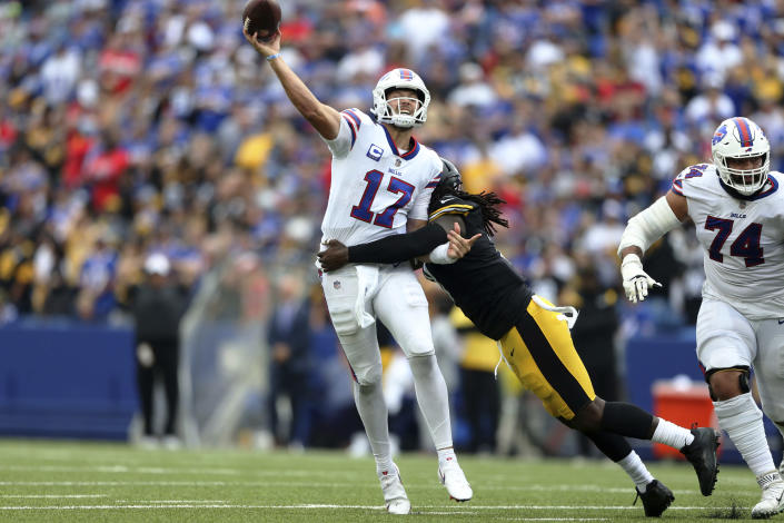 Buffalo Bills quarterback Josh Allen (17) gets off a pass as he is hit by Pittsburgh Steelers linebacker Melvin Ingram during the second half of an NFL football game in Orchard Park, N.Y., Sunday, Sept. 12, 2021. (AP Photo/Joshua Bessex)
