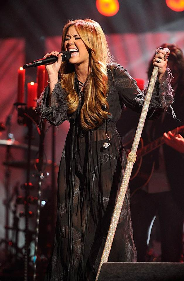 "Although Miley's personal life took a hit in late 2010 between the breakup of her parents' marriage and and her split with Liam after more than a year together, she was still succeeding professionally ... well, sort of. She was invited to perform at the 2010 American Music Awards, but her performance of the ballad ""Forgiveness and Love"" was panned. According to ""Access Hollywood,"" she was originally planning to sing ""Every Rose Has Its Thorn,"" but changed her mind at the last minute. Mazur AMA 2010/<a href=""http://www.wireimage.com"" target=""new"">WireImage.com</a> - November 21, 2010"