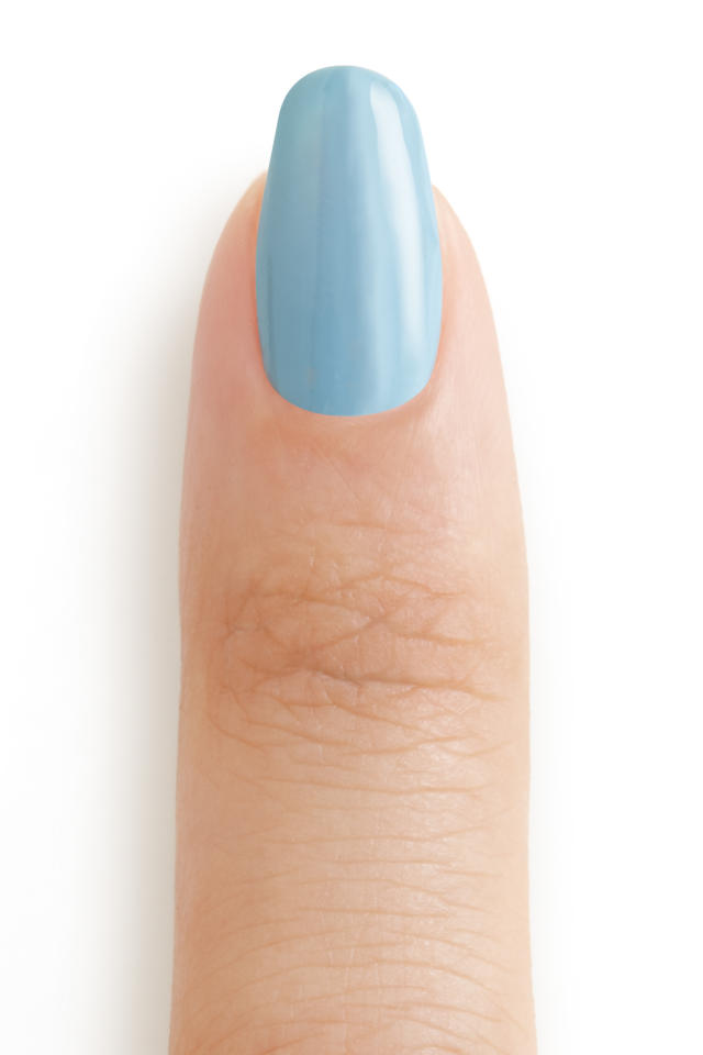 "<p>Next, apply one coat of <a rel=""nofollow"" href=""http://www.essie.com/Colors/blues/udon-know-me.aspx"">Udon Know Me</a> (a stone blue) to each nail. (Photo: Essie) </p>"