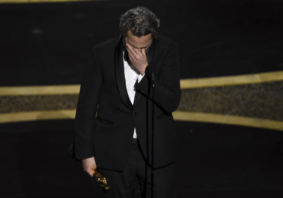 """Joaquin Phoenix reacts as he accepts the award for best performance by an actor in a leading role for """"Joker"""" at the Oscars on Sunday, Feb. 9, 2020, at the Dolby Theatre in Los Angeles. (AP Photo/Chris Pizzello)"""