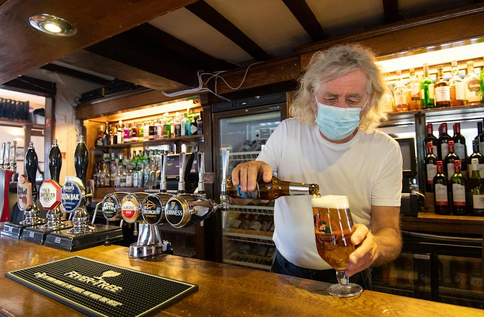 """Phil Weaver, owner of The Old Smithy in Church Lawford, Warwickshire pours a drink as pub and hospitality bosses have cheered the Government's proposals to allow customers through their doors again on July 4 as """"a welcome relief"""". (Photo by Joe Giddens/PA Images via Getty Images)"""