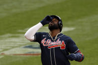 Atlanta Braves designated hitter Marcell Ozuna celebrates a solo home run against the New York Mets during the ninth inning of a baseball game Saturday, July 25, 2020, in New York. (AP Photo/Adam Hunger)