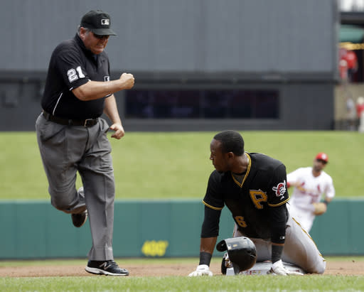 Umpire Hunter Wendelstedt calls Pittsburgh Pirates' Starling Marte out after Marte attempted to steal third base during the first inning of a baseball game against the St. Louis Cardinals on Thursday, Aug. 15, 2013, in St. Louis. (AP Photo/Jeff Roberson)