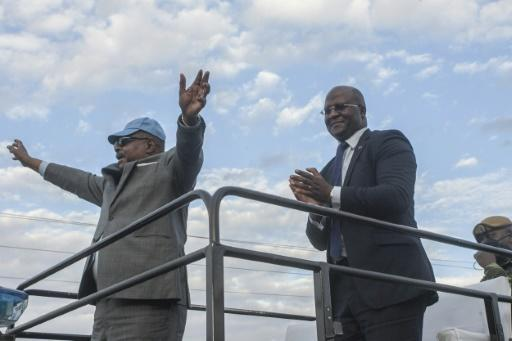 "Citing ""grave"" and ""widespread"" rigging, Malawi's constitutional court ruled in February that President Peter Mutharika (L) had not been duly elected, and mandated a new poll"