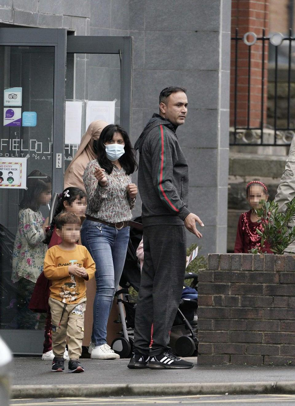 People leave the Sheffield Metropolitan Hotel in Blonk Street, where a five year old boy, an Afghan refugee whose family recently fled the Taliban, died after he fell from a window on Wednesday. (Peter Byrne/PA) (PA Wire)