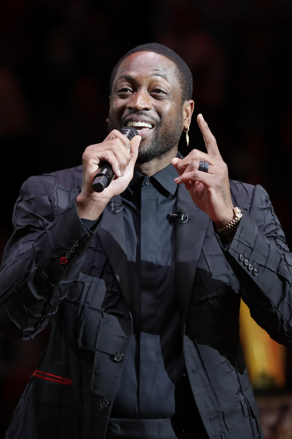 Former Miami Heat guard Dwyane Wade talks during a jersey retirement ceremony at halftime of an NBA basketball game between the Heat and the Cleveland Cavaliers, Saturday, Feb. 22, 2020, in Miami. (AP Photo/Wilfredo Lee)
