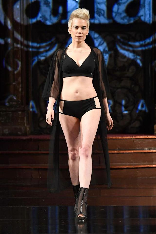 <p>Model wears a black bra, panty, and sheer robe at the AnaOno x #Cancerland show during NYFW. (Photo: Getty) </p>