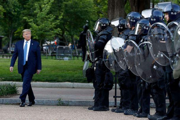 PHOTO: President Donald Trump walks past police in Lafayette Park after he walked to St. John's Church across from the White House, June 1, 2020, in Washington, D.C. Part of the church was set on fire during protests the previous night. (Patrick Semansky/AP)