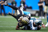 Carolina Panthers quarterback Sam Darnold is sacked by New Orleans Saints' Bradley Roby during the second half of an NFL football game Sunday, Sept. 19, 2021, in Charlotte, N.C. (AP Photo/Jacob Kupferman)
