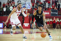 Butler forward Jordan Tucker (1) drives past St. John's guard Julian Champagnie (2) during the first half of an NCAA college basketball game Tuesday, Dec. 31, 2019, in New York. (AP Photo/Julius Constantine Motal)