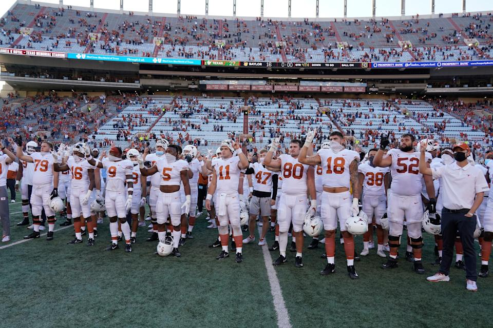 """Texas players, including Sam Ehlinger (11), sing """"The Eyes Of Texas"""" after the Oct. 24, 2020 against Baylor in Austin, Texas."""