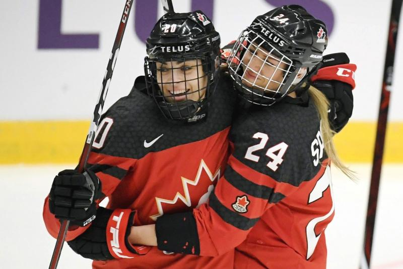FILE - In this April 4, 2019, file photo, Canada's Sarah Nurse, left and Natalie Spooner celebrate Spooner's goal against Switzerland during a Hockey Women's World Championships preliminary match in Espoo, Finland. Canada and the United States teammates renew their fierce hockey rivalry on Saturday, Dec. 14, in Hartford, Conn., with players hoping the first in a series of five games will help kindle the public's interest in their sport and their fight for better professional opportunities. (Antti Aimo-Koivisto/Lehtikuva via AP, File)