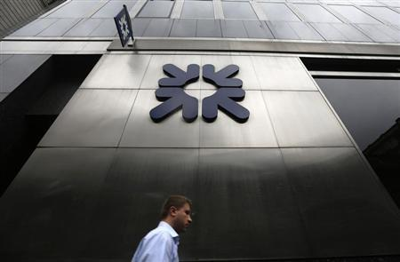 A man passes a branch of Royal Bank of Scotland (RBS) in London