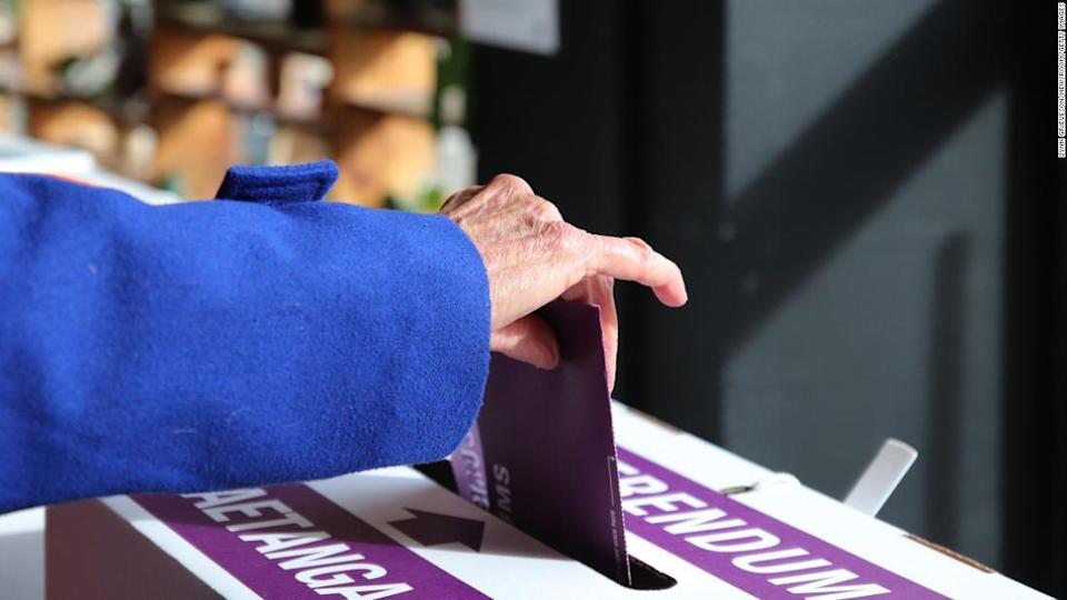 "<p>A woman places her referendum voting paper in the ballot box as advance voting begins on October 3 in Wellington, New Zealand.</p><div class=""cnn--image__credit""><em><small>Credit: Lynn Grieveson/Newsroom/Getty Images / Getty Images</small></em></div>"