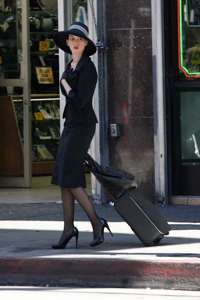 "We're getting close, ""Batman"" fans! With the highly-anticipated ""The Dark Knight Rises"" to be released next summer, star Anne Hathaway shot scenes as the sophisticated Selina Kyle -- better known as Catwoman -- in Los Angeles on Wednesday. PhamousFotos/<a href=""http://www.splashnewsonline.com"" target=""new"">Splash News</a> - September 7, 2011"