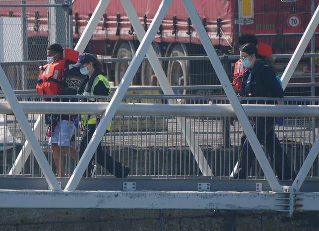 People thought to be migrants are brought ashore in Dover