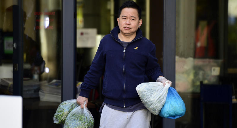 Man carrying plastic bags as he evacuated the building.
