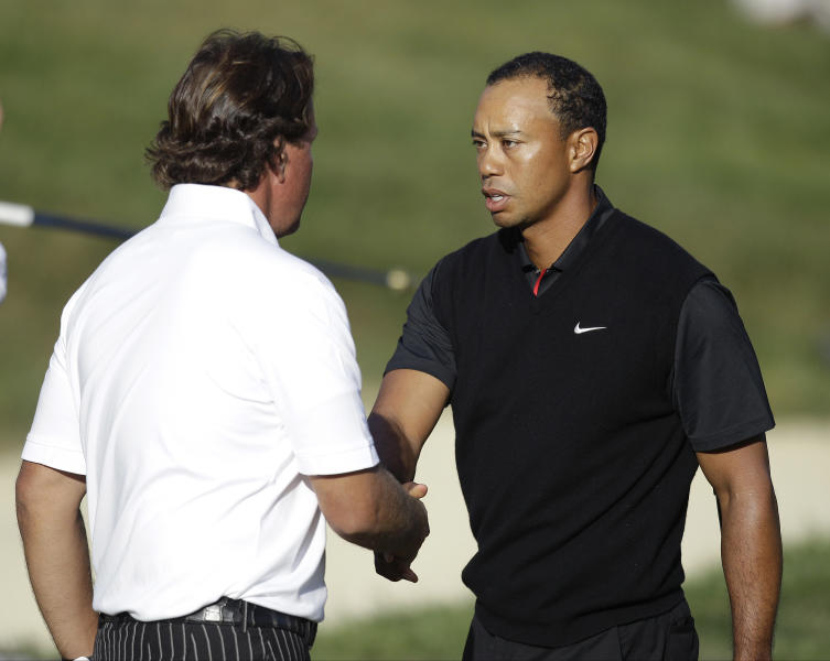 Tiger Woods and Phil Mickelson shake hands after the second round of the U.S. Open Championship golf tournament Friday, June 15, 2012, at The Olympic Club in San Francisco. (AP Photo/Ben Margot)