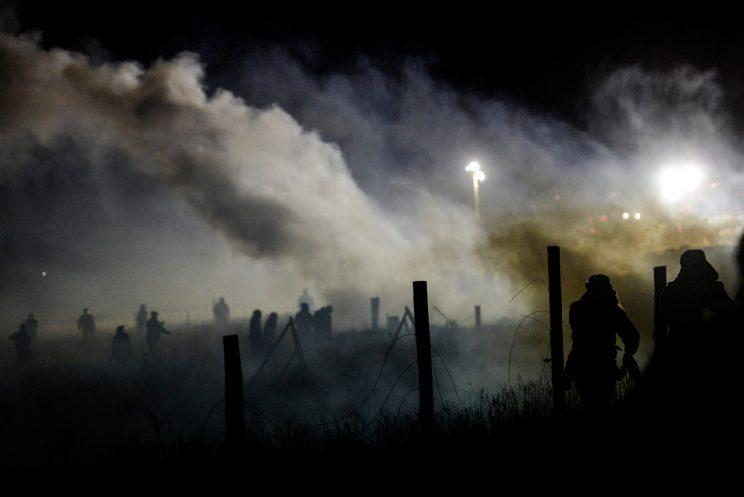 Police use tear gas to disperse protesters during a demonstration against the Dakota Access pipeline in Cannon Ball, N.D., on Sunday. (Stephanie Keith/Reuters)