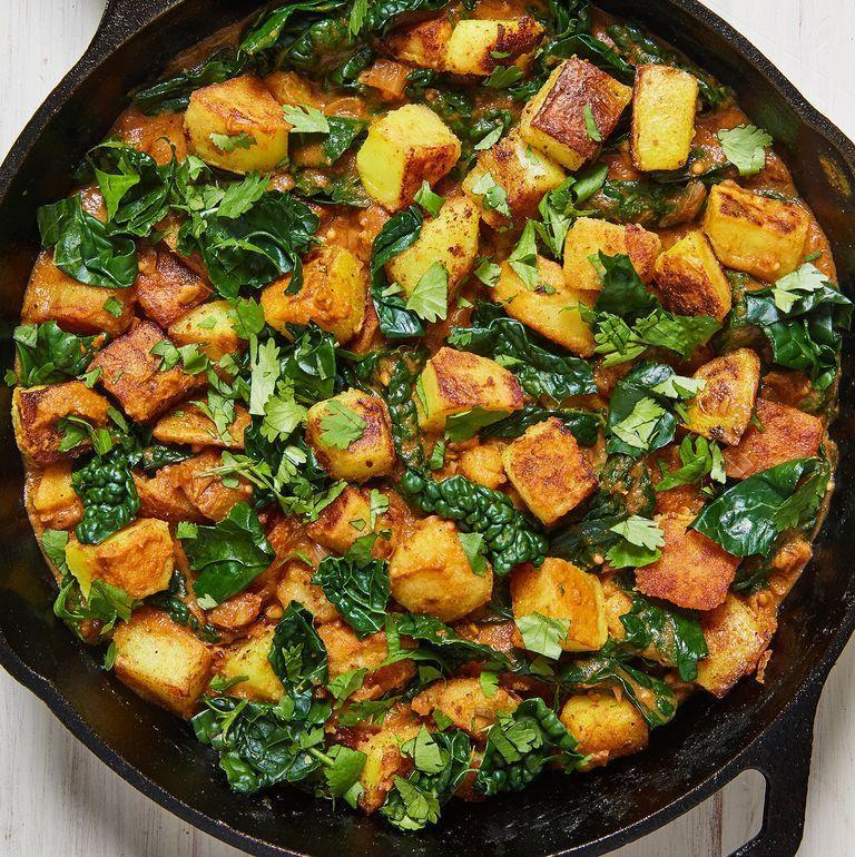 "<p>This Sag Aloo recipe is one of my favourite <a href=""https://www.delish.com/uk/cooking/recipes/g28795355/healthy-potato-side-dishes/"" rel=""nofollow noopener"" target=""_blank"" data-ylk=""slk:potato side dish"" class=""link rapid-noclick-resp"">potato side dish</a> ideas. And I personally think no <a href=""https://www.delish.com/uk/curry-recipes"" rel=""nofollow noopener"" target=""_blank"" data-ylk=""slk:curry"" class=""link rapid-noclick-resp"">curry</a> feast is complete without a side bowl of this carb-loaded goodness. I've swapped in spinach for <a href=""https://www.delish.com/uk/cooking/recipes/g30700699/kale-recipes/"" rel=""nofollow noopener"" target=""_blank"" data-ylk=""slk:kale"" class=""link rapid-noclick-resp"">kale</a>, so it's not strictly traditional, but if you're not fancying that then just add <a href=""https://www.delish.com/uk/cooking/a29469948/how-to-cook-spinach/"" rel=""nofollow noopener"" target=""_blank"" data-ylk=""slk:spinach"" class=""link rapid-noclick-resp"">spinach</a> instead - simple! </p><p>Get the <a href=""https://www.delish.com/uk/cooking/recipes/a31951261/sag-aloo/"" rel=""nofollow noopener"" target=""_blank"" data-ylk=""slk:Sag Aloo"" class=""link rapid-noclick-resp"">Sag Aloo</a> recipe.</p>"