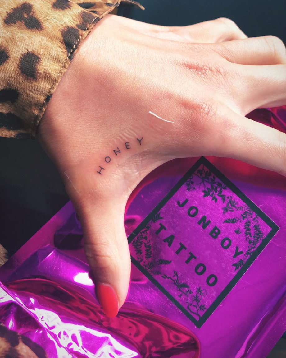 """<p>For weekend one, Shay leaned hard into the music festival hype and literally got a tattoo at Coachella. She got """"honey"""" tatted onto her hand and it's SO adorable. </p>"""