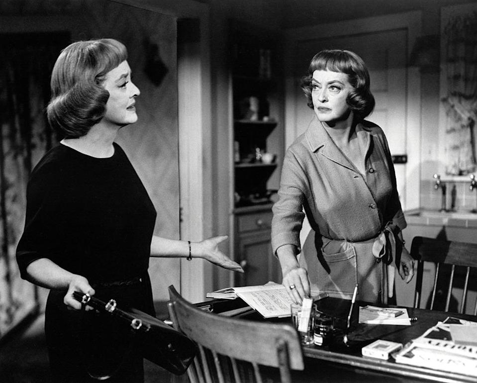 <p>Nearly 20 years later in 1964, Davis was at it again, playing an identical twin who assumes the identity of her dead sister. The twist this time: She killed her! <i>(Photo: Everett Collection)</i></p>