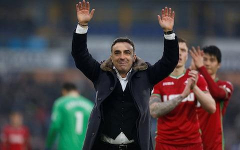 "Carlos Carvalhal needed all of his fire-fighting skills to get Swansea out of Huddersfield with a point. His team were a man down for almost 80 minutes against their relegation rivals, failed to manage a single shot on target and had less than 20 per cent of the possession. In the circumstances, a draw must have felt like a victory. Carvalhal would never admit it publicly, but there must have been a degree of satisfaction in thwarting Huddersfield, who beat his Sheffield Wednesday side on penalties en route to promotion via last season's Championship play-offs. Since moving to south Wales in December, his new team have lost just two of 16 games in all competitions. Survival, which looked highly unlikely at Christmas, is getting closer by the week. They would not have got their draw, though, but for a brilliant save by Lukasz Fabianski with just under half-an-hour to go. The Polish goalkeeper thrust up an arm to get a faint touch after Steve Mounie had hit a thunderous dipping volley. Fabianski's intervention was enough to turn the ball on to the bar. There was an even later escape for the visitors, as Tom Ince headed the excellent Florent Hadergjonaj's cross against the post. Huddersfield were left to rue a failure to score from any of their 28 efforts on goal. Swansea showed no ambition after the early sending off of Jordan Ayew; as far as they were concerned, it was all about putting out ""the fire in the forest"", as Carvalhal described their fight for survival on Thursday. It was not attractive to watch, but his players got the job done. Andre Ayew was sent off after this tackle on Jonathan Hogg in the 11th minute Credit: Getty Images Ayew, Swansea's 10-goal leading scorer, was sent off in the 10th minute for a reckless challenge on Huddersfield captain Jonathan Hogg. Ayew could have little complaint about the decision; he may have gone into the challenge without any malice, but he went studs first into the midfielder's leg. If Carvalhal had gone into the game with any attacking ambition, it disappeared at that moment. The 5-3-2 formation with which he started the afternoon became, at times, a 5-4-0, with Andre Ayew, the sole remaining striker, frequently dropping back to help a deep-lying midfield whenever Huddersfield had the ball. The home side had plenty of chances, even so. Ince glanced a fine Hadergjonaj cross well wide, while Mounie climbed above Federico Fernandez to loop a back header on to the roof of the net. Swansea's hopes of a clean sheet should have disappeared six minutes after half-time as Ince delivered an excellent ball from the right towards Scott Malone, only for the left-back, still seeking his first goal for Huddersfield, to miss his kick while attempting the volleyed finish. Carlos Carvahal salutes the travelling Swansea fans after the goalless draw Credit: Reuters When Swansea had a rare chance on the hour mark, it appeared to take even their own players by surprise; Ki Sung-yueng's low outswinging free-kick found Mike van der Hoorn getting himself in front of Huddersfield's sleeping defenders, and then dawdling himself, allowing the home side to clear. That left-off jolted Huddersfield back into action; the lively Mounie swept Hadergjonaj's cross on the run into the side-netting, and then was denied by Fabianski's astonishing acrobatics. Moments after that, Hadergjonaj steered a first-time shot just wide from Mooy's short corner. As the clock ticked down, Swansea sensed a point was within reach; thanks to the post denying Ince right at the end, they got it. ""Before the game it was a good point and after it was massive one,"" admitted Carvalhal. Huddersfield coach David Wagner said: ""I don't think I've been involved in a game so one-sided. It's very frustrating."""