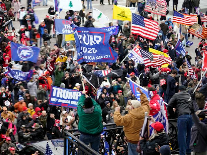 <p>Violent protesters gather outside the US Capitol in Washington on 6 January, 2021</p> (AP)