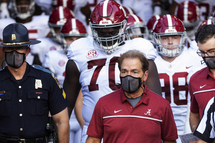 FILE - In this Sept. 26, 2020, file photo, Alabama coach Nick Saban leads his team to the field before an NCAA college football game against Missouri in Columbia, Mo. Saban and athletic director Greg Byrne have tested positive for COVID-19, four days before the Southeastern Conference's biggest regular-season showdown. The second-ranked Crimson Tide is set to face No. 3 Georgia on Saturday, and may be without their iconic 68-year-old coach. (AP Photo/L.G. Patterson, File)