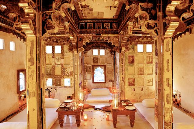 Devi Garh, Udaipur - The hotel was restored and rebuilt showcasing the best of Indian contemporary design within a heritage property. Ensure you arrange for an exclusive dinner in the magical Sheesh Mahal chamber, located at the highest point in the fort. Traces of history can be found in the carved archways and faded frescoes, while flickering candles illuminate original, coloured mirror work and elaborate ceramic decorations. Feast on a delicious thali and order a bottle of fine champagne.