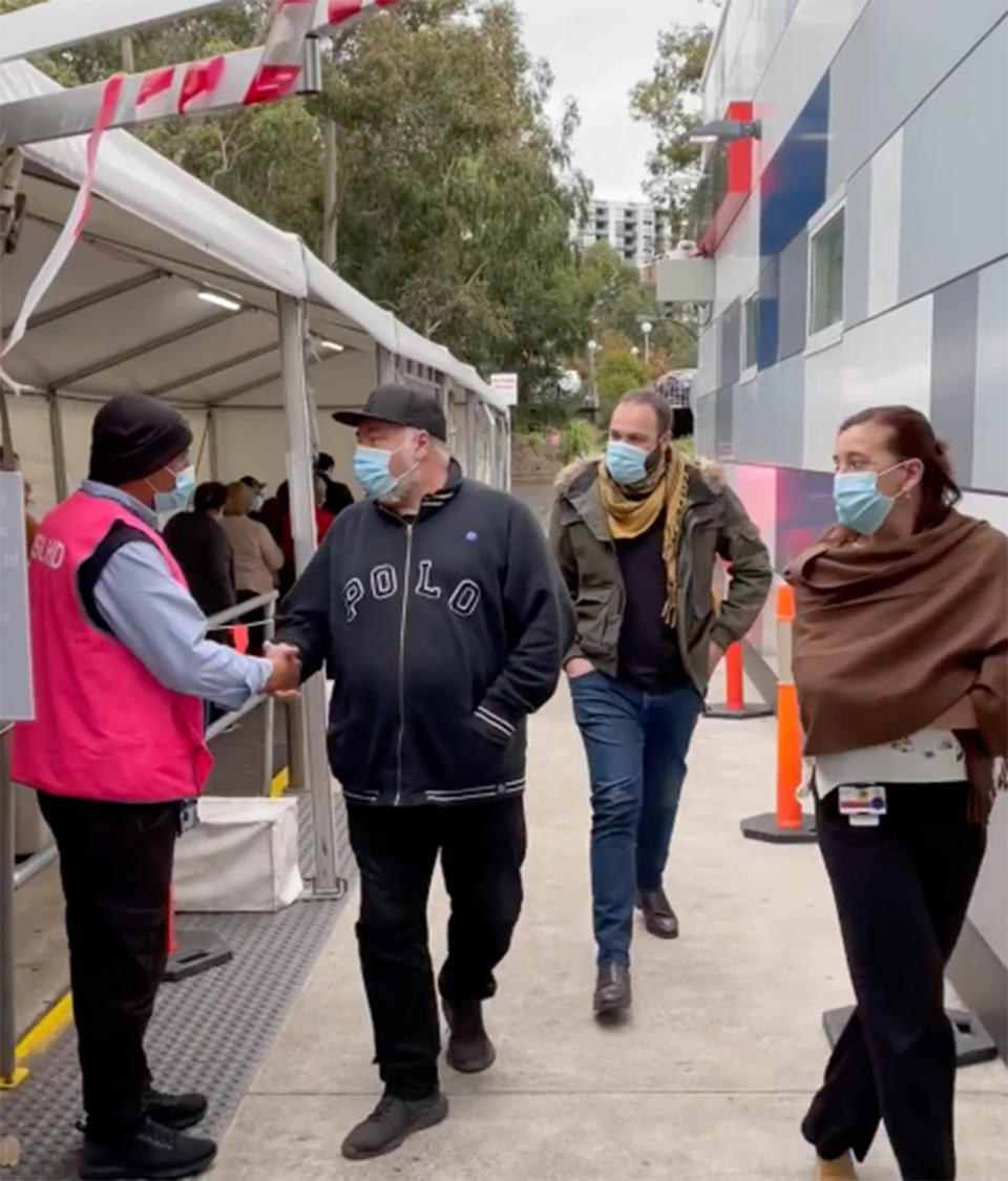 Kyle Sandilands walks into Westmead Hospital in western Sydney on Tuesday afternoon to receive the COVID-19 vaccine