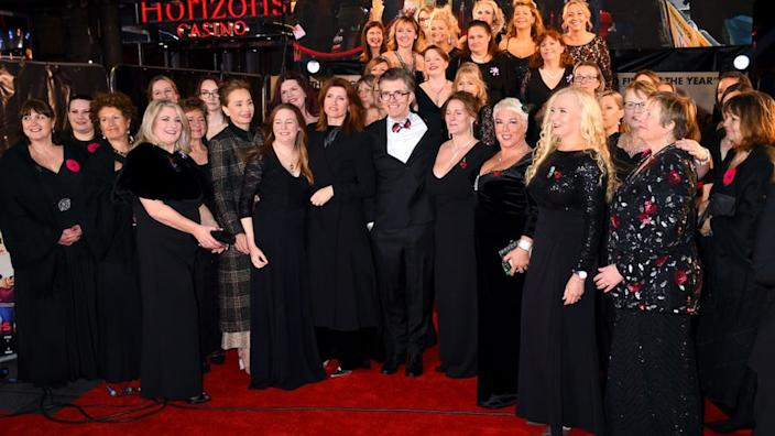 Kristin Scott Thomas, Gareth Malone and Sharon Horgan with the Combined Military Wives Choir at their London UK film premiere in February