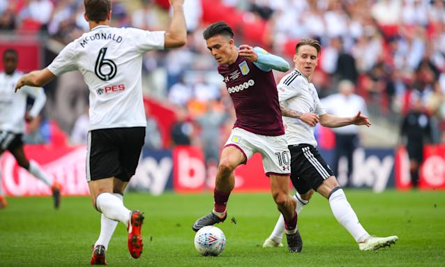 Jack Grealish of Aston Villa attempts to weave a way through the Fulham defence in the championship play-off final.