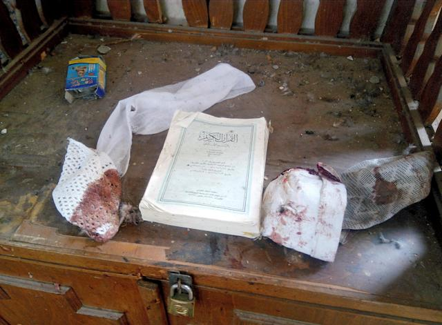 <p>A Quran and remnants of personal belongings of victims of the explosion are seen at Al Rawdah mosque are seen in Bir Al-Abed, Egypt, Nov. 25, 2017. (Photo: Mohamed Soliman/Reuters) </p>