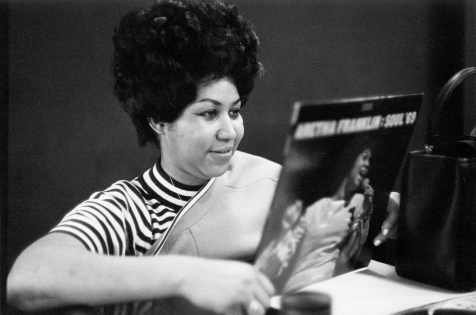 Aretha Franklin holds up her <em>Soul '69</em> album in the Atlantic Records studios on Jan. 9, 1969, in New York. (Photo: Michael Ochs Archives/Getty Images)