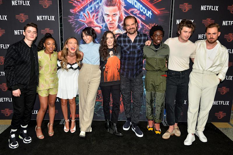 HOLLYWOOD, CALIFORNIA - NOVEMBER 09: (L-R) Noah Schnapp, Priah Ferguson, Millie Bobby Brown, Carmen Cuba, Winona Ryder, David Harbour, Caleb McLaughlin, Joe Keery and Dacre Montgomery arrive at Netflix's 'Stranger Things' Season 3 Photocall at Linwood Dunn Theater at the Pickford Center for Motion Study on November 09, 2019 in Hollywood, California. (Photo by Jerod Harris/WireImage)