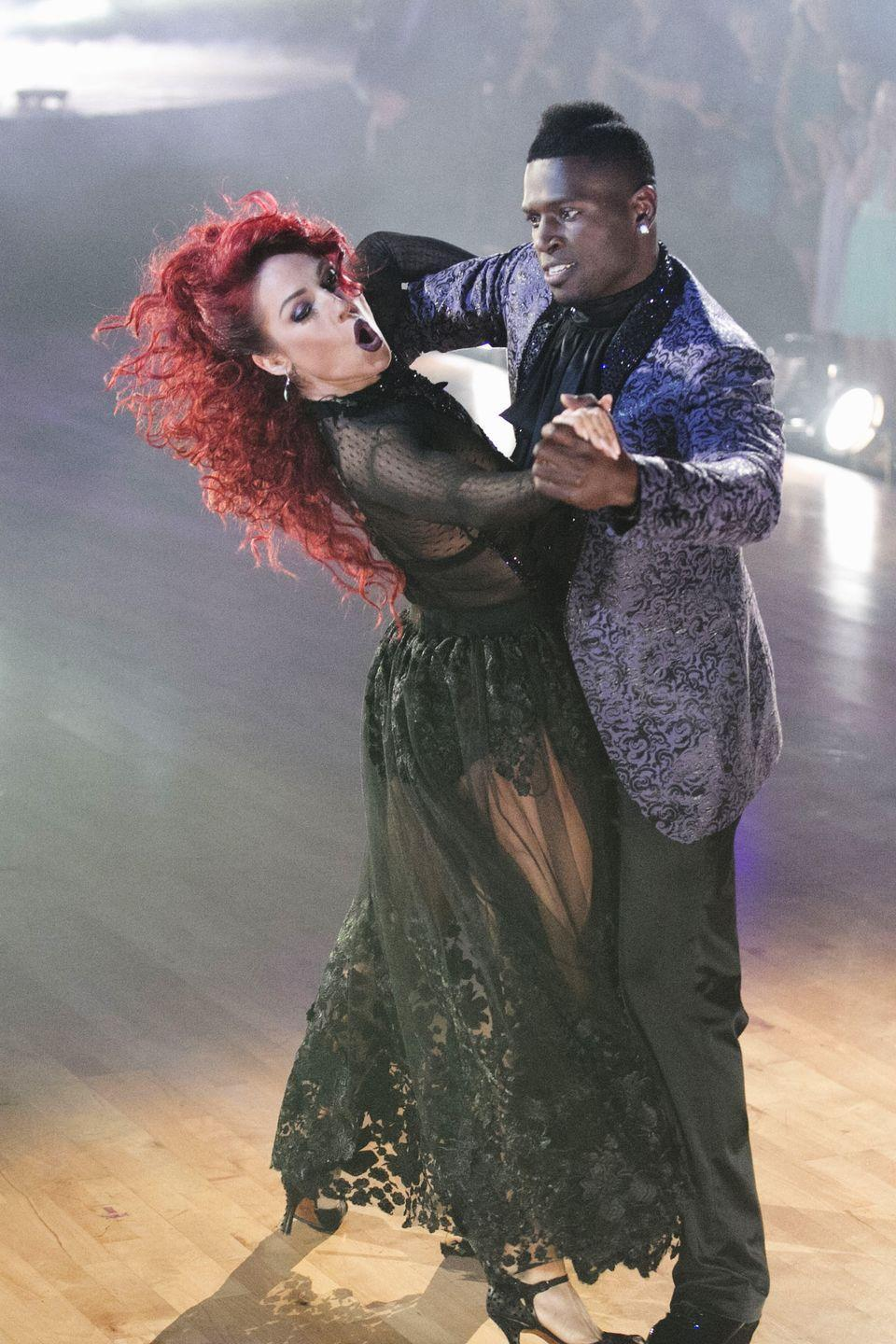 """<p>During a particularly intense tango with partner Antonio Brown, Sharna's black bustier began to slip down without her noticing. To her dismay, Tom Bergeron alerted her attention to it after they finished and the dancer laughed it off—<a href=""""https://www.inquisitr.com/3060615/sharna-burgess-suffers-nip-slip-and-two-other-wardrobe-malfunctions-on-dancing-with-the-stars/"""" rel=""""nofollow noopener"""" target=""""_blank"""" data-ylk=""""slk:although she later revealed"""" class=""""link rapid-noclick-resp"""">although she later revealed</a> it was one of her more embarrassing moments on the show. </p>"""