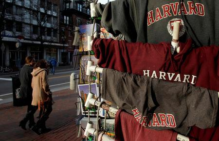 FILE PHOTO: People walk past Harvard University t-shirts for sale in Harvard Square in Cambridge, Massachusetts, U.S. on November 16, 2012. REUTERS/Jessica Rinaldi/File Photo