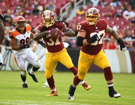 File photo: Aug 27, 2017; Landover, MD, USA; Washington Redskins running back Matt Jones (31) carries the ball as offensive guard Kyle Kalis (67) blocks against the Cincinnati Bengals during the second half at FedEx Field. Mandatory Credit: Brad Mills-USA TODAY Sports